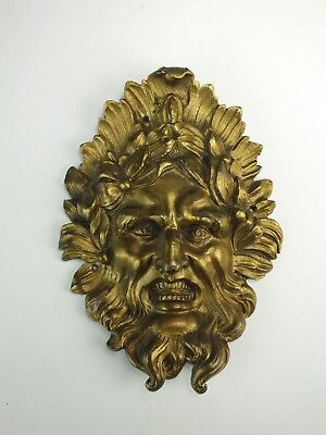 Ornate vintage gilt brass Green Man mask plaque, furniture or clock ornament