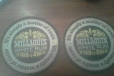 millaquin white rum round coasters with black boarders x2