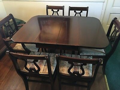 Duncan Phyfe Mahogany Drop Leaf Table with 6 Chairs - $500. Local pickup