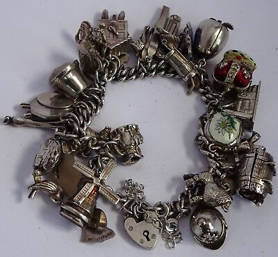 Wonderful vintage solid sterling silver charm bracelet & 32 silver charms, Nuvo