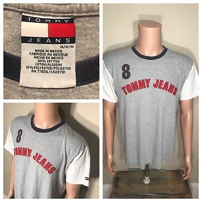 75c2da56 Vintage Tommy Hilfiger jeans T-Shirt Two Tone Spell out Flag #8 Medium rugby