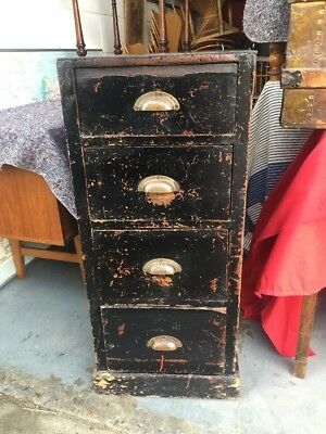 Antique panelled drawers with metal handles, industrial vintage Victorian.