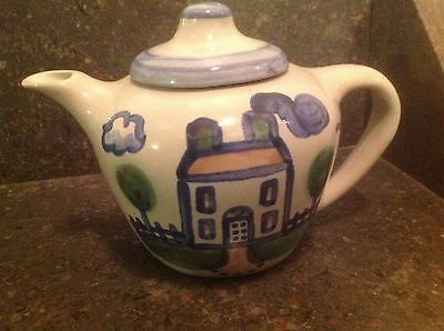 M A Hadley tea pot with house design