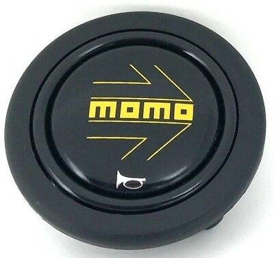 Genuine Momo yellow arrow on black steering wheel horn push button. BRAND NEW