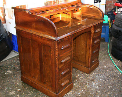 Lebus Oak Roll Top Six Drawer Desk