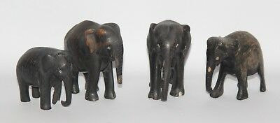 Collection of 4 Vintage Hand Carved Wooden Elephant Ornaments