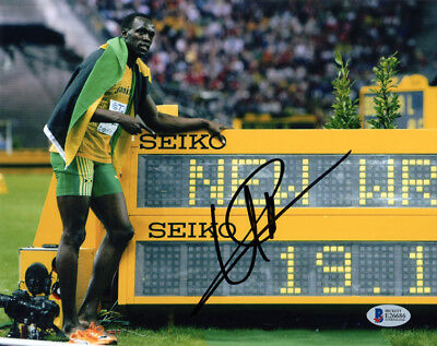 USAIN BOLT SIGNED AUTOGRAPHED 8x10 PHOTO OLYMPIC TRACK GOLD MEDALIST BECKETT BAS