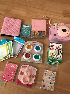 fuji instax camera and acccesories frames books pink camera With film included
