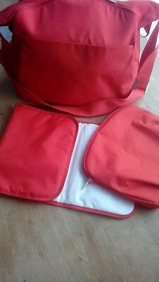 Stokke changing bag with mat and dummy bag red