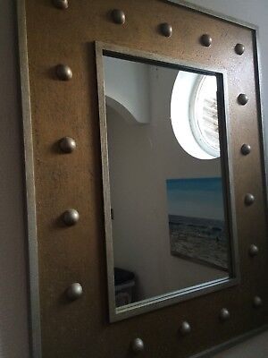 Large contemporary gilt coloured mirror with raised detailing