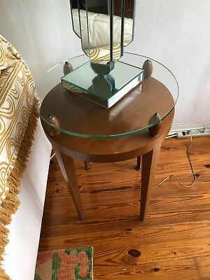Mid century design glass top side table with shelf and wooden base.