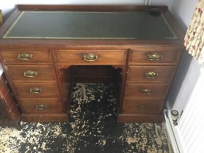 antique writing desk very very good condition, nine drawers.