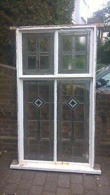 salvaged leaded windows in crittall frames secured to original timber frame