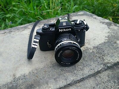 Nikon EM 35mm film camera with Nikon Series E 50mm 1;1.8  lens