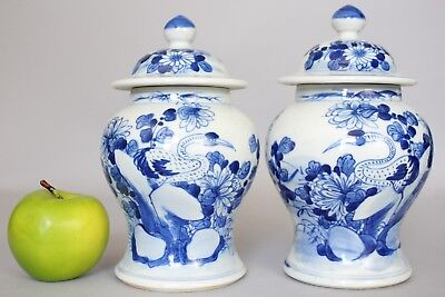 A facing pair of Chinese blue & white lidded baluster crane vases 19thc Qing