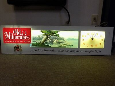 Very rare 1963 Old Milwaukee clock and lighted sign with fishing background