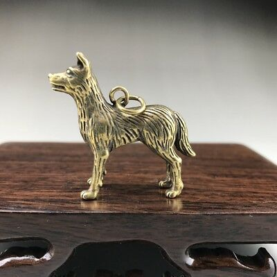 Pure copper pendant in ancient China, pure hand-carved dog image.