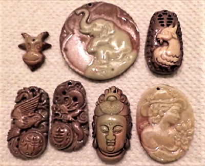 A Fabulous Varied Collection of Zi Pao Jade Artwork Pendants -  61.4 grams