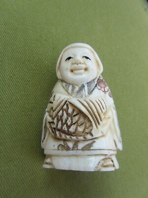 A very pleasing Lady/Queen signed bone netsuke