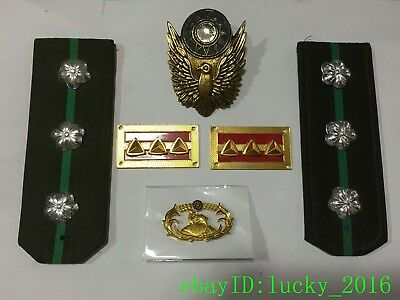 During World War II, the KMT Cap Badge, shoulder badge,complete set