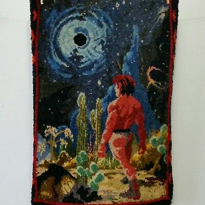 Vtg Latch Hook Rug Hanging Tapestry Man in Thong Stands Among Cactus at Night