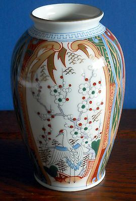 A medium Japanese porcelain Vase decorated with Cranes and Blossom