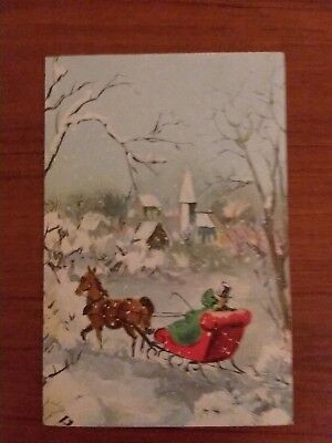Vintage Christmas Greeting Card Couple in Horse Drawn Sleigh Wintry Scene