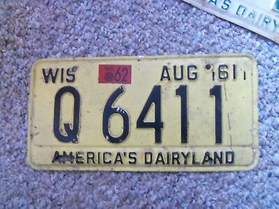 1961-62  Wisconsin License Plate Plate 62 Ford ? 61 Chev  61 Ford 62 Chevrolet?