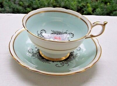 Lovely Paragon  Cup And Saucer Pale Blue Field Hand Painted Florals
