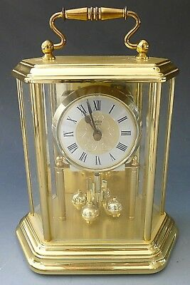 Vintage ACCTIM pendulum brass anniversary mantel clock in glass hexagonal case
