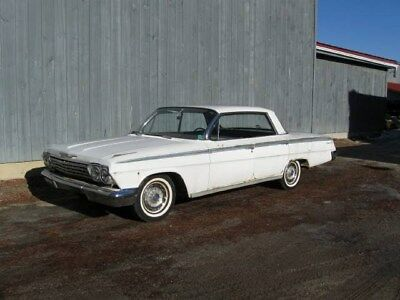 1962 Chevrolet Impala  1962 Chevrolet Impala. Bench seats and runs great. All white with silver hubcaps
