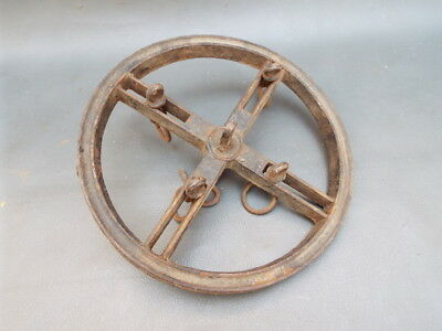 Antique cast iron wheel for a brass meat spit or roasting jack