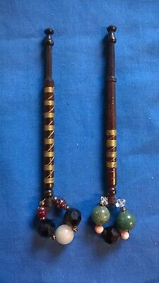 Pair of wooden lace making bobbins, with wire around shank, and spangles
