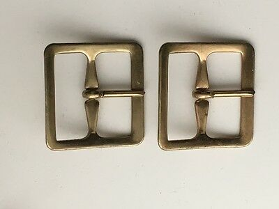 A Pair of New Brass Buckles
