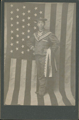 Sailor Standing in Front of American Flag