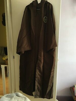Xtra large brown hooded jedi cape with sash. Used once with logo.