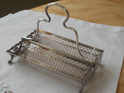Vintage Van Bergh Silver Plate Company's sweet two-row filigree condiment caddy