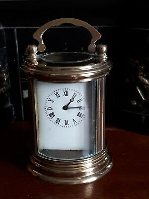 Round brass carriage clock 20th century 5cm white dial face