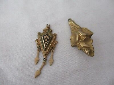 Antique gold filled lot of two pendants hanging arrows black