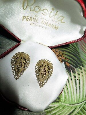 Wonderful pair of vintage Deco gold filigree dress clips