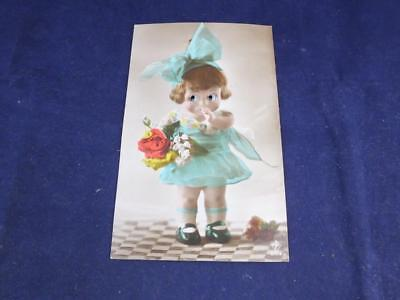 Vintage Novelty Postcard Moving Eyes Girl in Blue with Flowers.