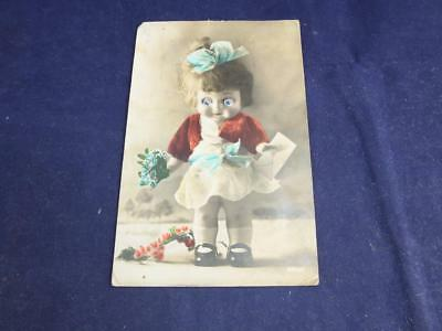 Vintage Novelty Postcard Moving Eyes Girl with Blue Bow and Flowers.