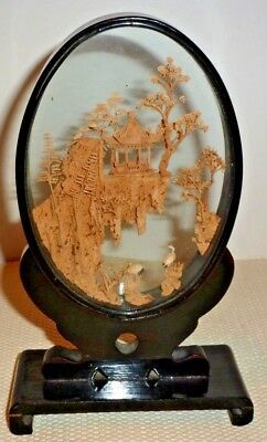Oval framed Chinese wood carving 20.5 cms tall x 12cms wide