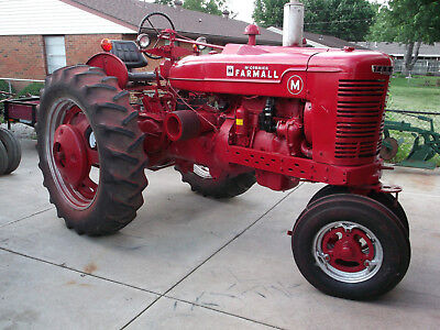 1950 Farmall M tractor and 314 Plows