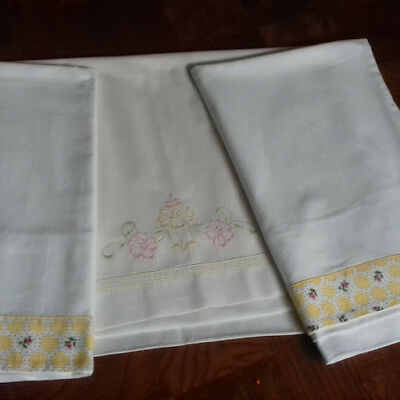 Vintage pair of cotton pillowcases and single linen pillowcase with roses