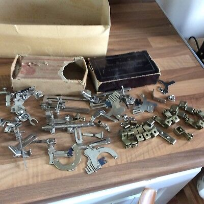 A Collection Of Singer Sewing Machine,parts,boxes Etc