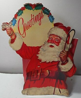 2 Santa Claus posters gift bag leather gloves whip Greetings advertisement?