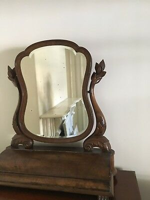 Antique Victorian walnut mirror with hinged storage compartment at base.