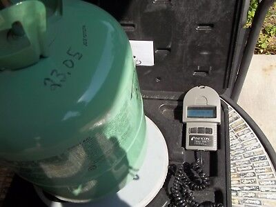 R22 Refrigerant 23 lbs 5 oz  TOTAL WEIGHT IN  30 lb Tank