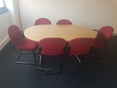 Wooden boardroom table with 6 chairs